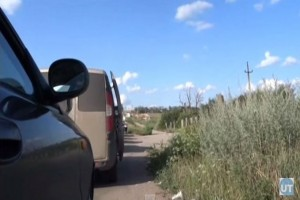 Ukraine Checkpoint Under Fire: Citizens take cover as sound of gunfire breaks out