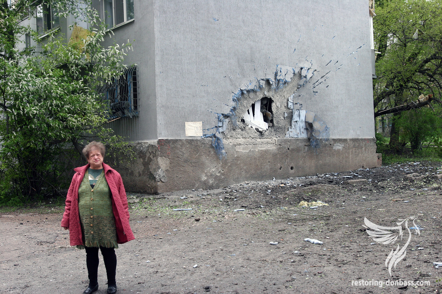 A direct hit of a shell in a wall of living building, Donetsk, May 3, 2015