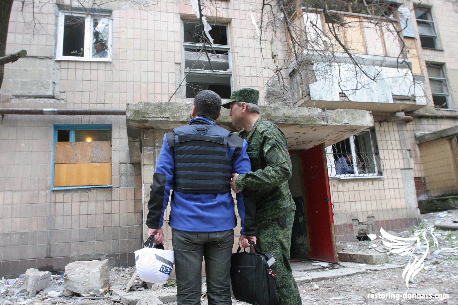 The representative of the OSCE mission examines the result of the shelling of house in Donetsk, May 3, 2015