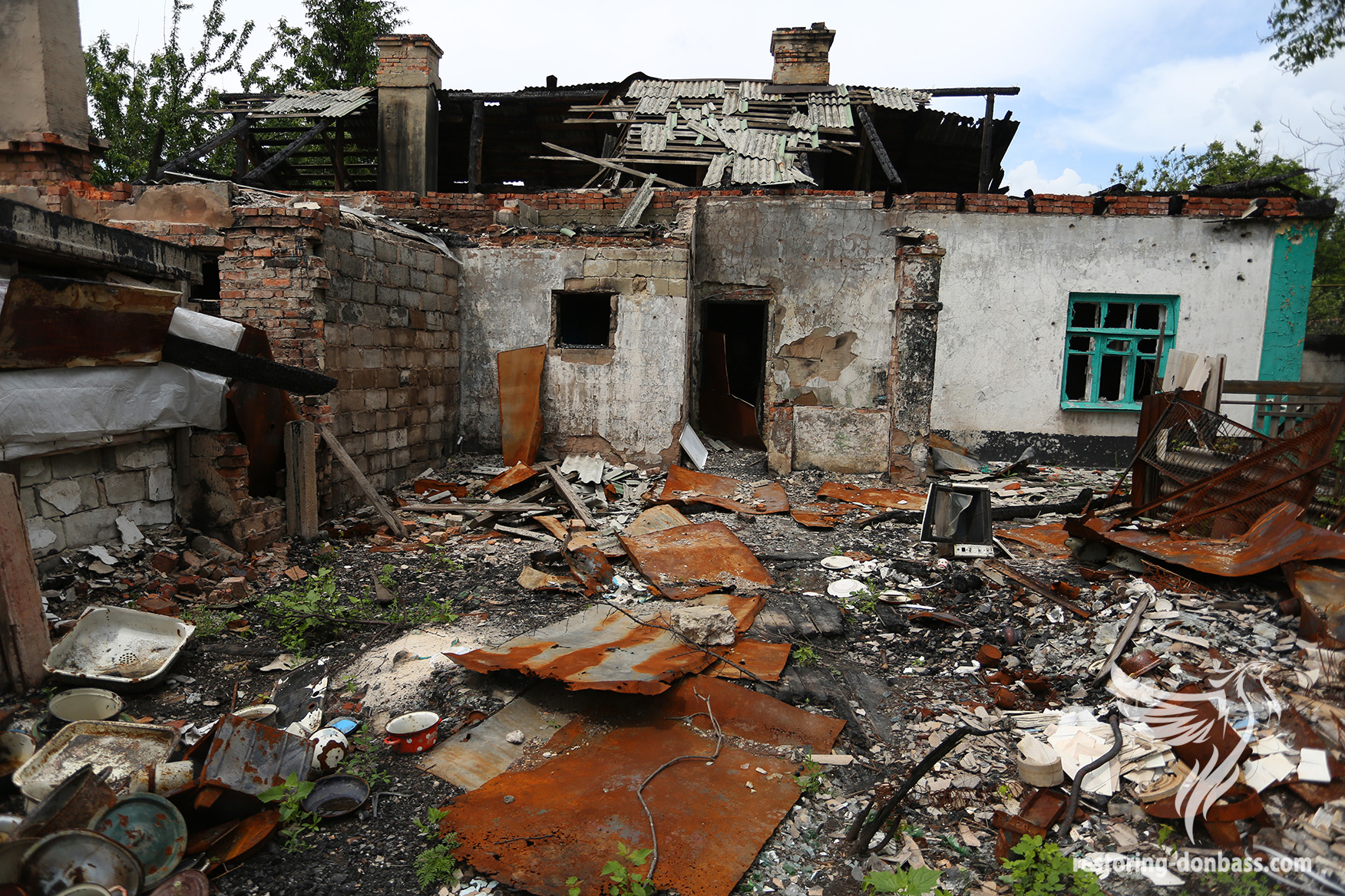 The house, which was destroyed by shells, Oktyabrskiy village, Donetsk, June 1, 2015
