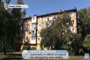 Donetsk Residents Caught in Crossfire: Apartments in militant-held city damaged by more shelling