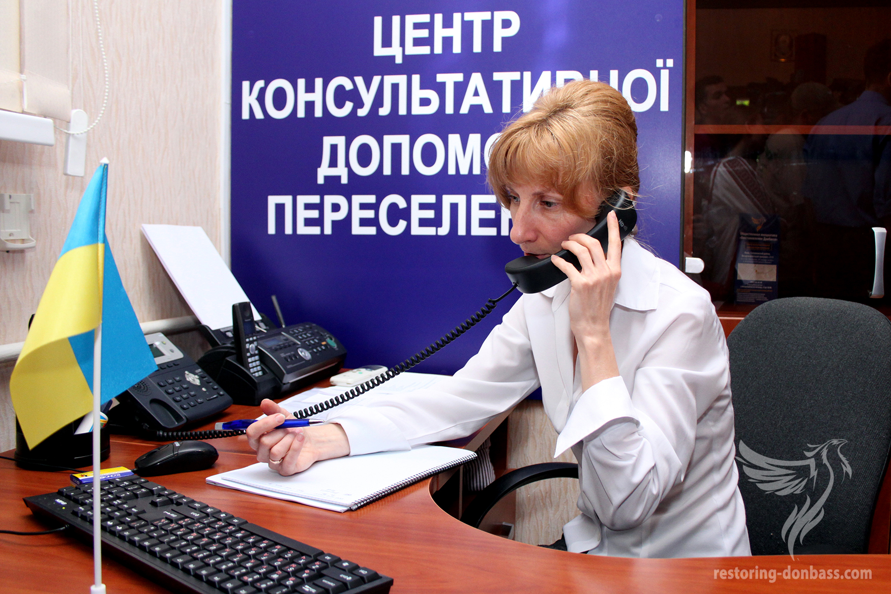 Operator of the hot line Irina Golina is giving advices to internally displaced person, 30.07.2015
