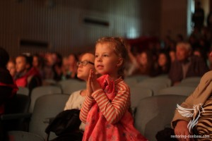 Young spectator of the concert supports the acting