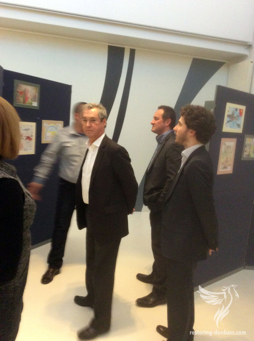 How did exhibition of children's drawings was carried out in Brussels? Report